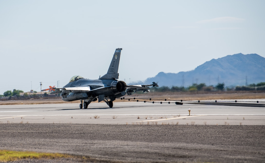 An F-16C Fighting Falcon stops after catching an emergency cable during an annual drill to recertify the BAK-12 arresting system May 8, 2020, at Luke Air Force Base, Ariz.