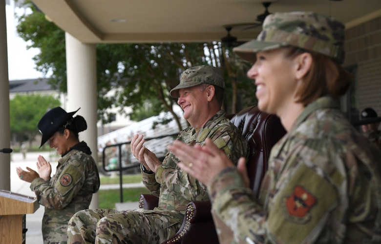 U.S. Air Force Lt. Gen. Brad Webb, commander of Air Education and Training Command, and Chief Master Sgt. Julie Gudgel, AETC command chief, applaud during the basic military training graduation ceremony at Keesler Air Force Base, Mississippi, May 15, 2020. Nearly 60 Airmen from the 37th Training Wing Detachment 5 completed the six-week basic military training course. Due to safety concerns stemming from COVID-19, the Air Force sent new recruits to Keesler to demonstrate a proof of concept to generate the force at multiple locations during contingencies. The flight was the first to graduate BMT at Keesler since 1968. (U.S. Air Force photo by Kemberly Groue)