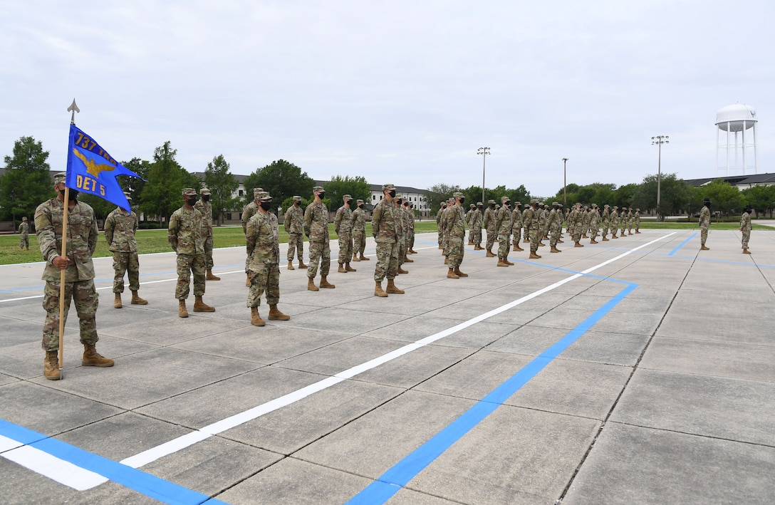 Graduating Airmen stand in formation on the drill pad during the basic military training graduation ceremony at Keesler Air Force Base, Mississippi, May 15, 2020. Nearly 60 Airmen from the 37th Training Wing Detachment 5 completed the six-week basic military training course. Due to safety concerns stemming from COVID-19, the Air Force sent new recruits to Keesler to demonstrate a proof of concept to generate the force at multiple locations during contingencies. The flight was the first to graduate BMT at Keesler since 1968. (U.S. Air Force photo by Kemberly Groue)