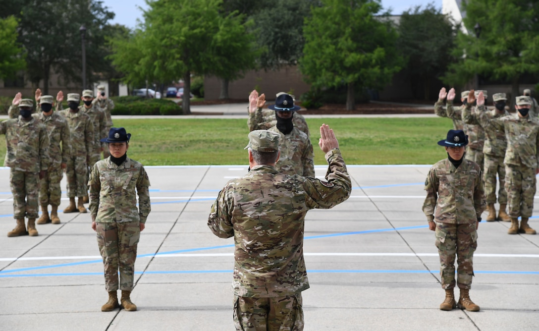 U.S. Air Force Lt. Gen. Brad Webb, commander of Air Education and Training Command, delivers the Oath of Enlistment during the basic military training graduation ceremony at Keesler Air Force Base, Mississippi, May 15, 2020. Nearly 60 Airmen from the 37th Training Wing Detachment 5 completed the six-week basic military training course. Due to safety concerns stemming from COVID-19, the Air Force sent new recruits to Keesler to demonstrate a proof of concept to generate the force at multiple locations during contingencies. The flight was the first to graduate BMT at Keesler since 1968. (U.S. Air Force photo by Kemberly Groue)