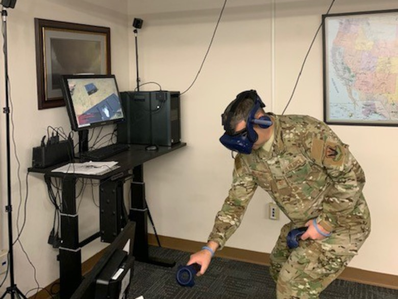 Airman using virtual reality equipment for training.