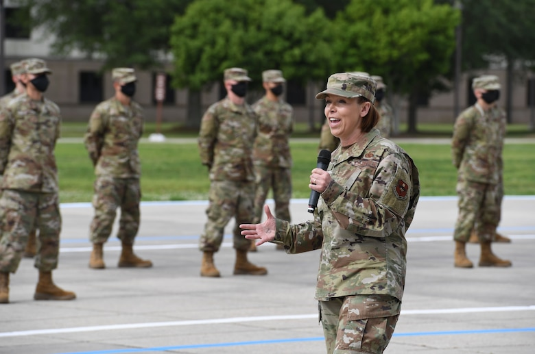 U.S. Air Force Chief Master Sgt. Julie Gudgel, Air Education and Training Command command chief, delivers remarks during the basic military training graduation ceremony at Keesler Air Force Base, Mississippi, May 15, 2020. Nearly 60 Airmen from the 37th Training Wing Detachment 5 completed the six-week basic military training course. Due to safety concerns stemming from COVID-19, the Air Force sent new recruits to Keesler to demonstrate a proof of concept to generate the force at multiple locations during contingencies. The flight was the first to graduate BMT at Keesler since 1968. (U.S. Air Force photo by Kemberly Groue)