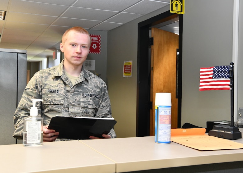 While the 104th Fighter Wing continues to support the COVID-19 response mission, Airmen behind-the-scenes are working hard to take care of their peers and ensure the mission continues to run smoothly.  Airman Jack Proulx is a financial management technician in the comptroller flight at the 104th Fighter Wing. He works part-time in the comptroller office while going to school full-time.  (U.S Air National Guard Photos by Master Sgt. Lindsey Sarah Watson-Kirwin)