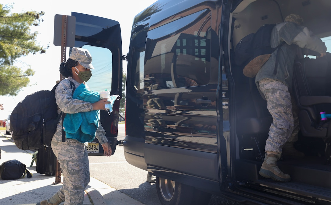 Airman 1st Class Tahlia Wilson, mental health technician, 59th Medical Group, Randolph Air Force Base, Texas, boards a van at Joint Base McGuire-Dix-Lakehurst, NJ, April 28, 2020. Wilson is a part of a six-member team that will provide behavioral health and support services to the service men and women that are provide care and medical services to COIVD-19 patients. U.S. Northern Command, through U.S. Army North, is providing military support to the Federal Emergency Management Agency to help communities in need. (U.S. Army photo by Sgt. Aimee Nordin)