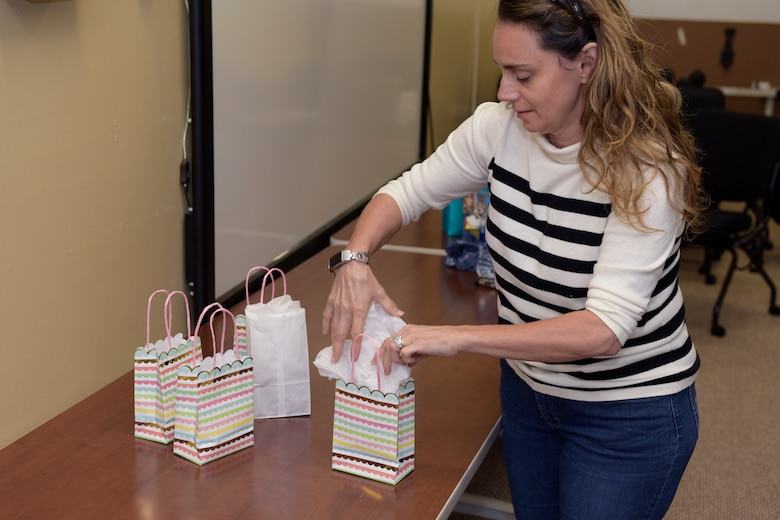 17th Training Wing Violence Prevention Integrator, Donna Casey, prepares packages for Military Training Leaders in the Adopt-An-MTL program by packing gift bags at the Violence Prevention building, Goodfellow Air Force Base, Texas, May 1, 2020. The Adopt-An-MTL program was created to let Goodfellow MTLs know they are not alone during the COVID-19 pandemic. (U.S. Air Force photo by Senior Airman Zachary Chapman)