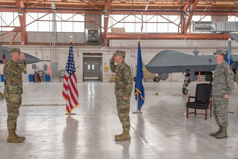 (Center) Col. Thomas Preston, incoming 49th Maintenance Group commander, renders a salute to Col. Joseph Campo, 49th Wing commander, as he assumes command of the 49th MXG, May 15, 2020, on Holloman Air Force Base, N.M. Preston was previously assigned to the U.S. European Command J4 as the operational logistics division chief in Stuttgart, Germany. (U.S. Air Force photo by Staff Sgt. Christine Groening)