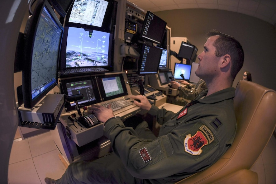MQ-9 Reaper pilot sits in flight simulator