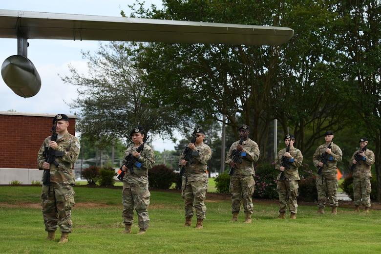 Airmen rendering a 21 gun salute.