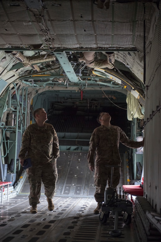 U.S. Air Force Master Sgt. Albert Kirkey, 818th Mobility Support Advisory Squadron team sergeant (left), and Master Sgt. Salvador Mascorro, 818th MSAS aircraft maintenance air advisor (right), look over an Ethiopian C-130 Hercules at Harar Meda Air Base, Ethiopia, Jan. 14, 2020. U.S. Air Force air advisors provided technical expertise to train Ethiopian Air Force aircrew on how to execute a C-130 mission profile to help support peacekeeping operations in the region. (U.S. Air Force photo by Staff Sgt. Sarah Brice)
