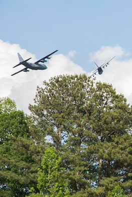 Two C-130H3 Hercules from Dobbins perform a flyover for Piedmont Mountainside hospital in Jasper, Ga. on May 14, 2020. The hospital flyover was one of several that day, serving as a way of saying thanks for all the tireless work healthcare workers and first responders have put in to help keep Georgia safe. (U.S. Air Force photo/Andrew Park)