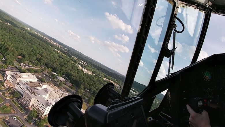 A C-130H3 Hercules from Dobbins flies over north Georgia en route to a number of hospitals in the region where it and another C-130 from Dobbins performed a flyover to show appreciation on May 14, 2020. The two C-130s took off from Dobbins around 6 p.m. that day and headed toward hospitals in Kennesaw, Canton, Japer, Dalton, Rome, Cartersville and Hiram. (U.S. Air Force photo/Master Sgt. Michael McGhee)