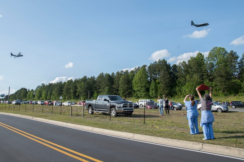 Healthcare workers from Piedmont Mountainside in Jasper, Ga. hold up a sign as two C-130H3 Hercules from Dobbins perform a flyover for the hospital on May 14, 2020. The hospital flyover was one of several that day, serving as a way of saying thanks for all the tireless work healthcare workers and first responders have put in to help keep Georgia safe. (U.S. Air Force photo/Andrew Park)