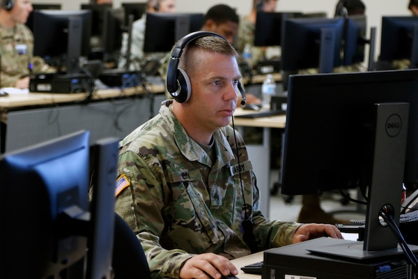 Soldiers with the 116th Army Band, Georgia Army National Guard, along with Airmen from both the 116th Airlift Wing and 165th Air Control Wing, operate a call center that helps facilitate testing through the Augusta University ExpressCare cellphone app. The Soldiers in the call center pull information from a database pool and help people experiencing possible COVID-19 symptoms find testing sites near them.