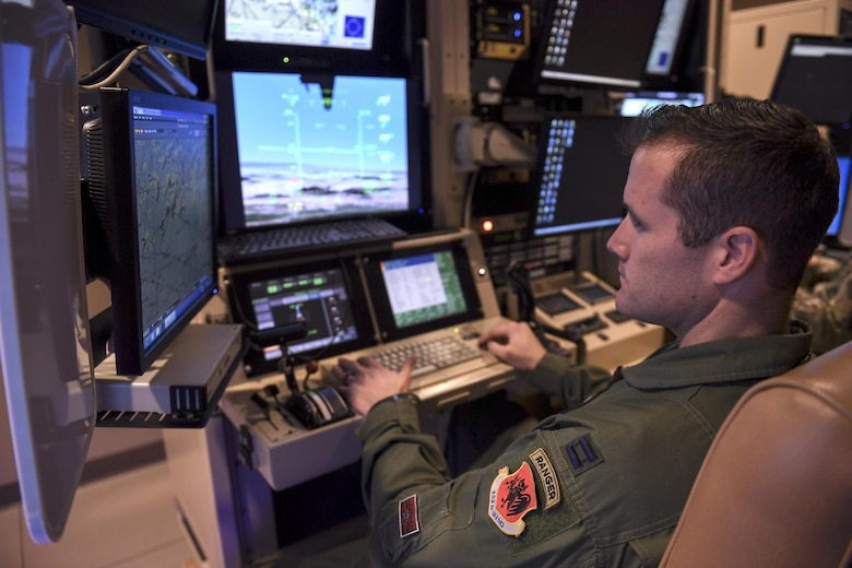 MQ-9 Reaper pilot sits in flight simulator