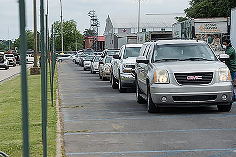 Photo of cars lining up for food boxes.