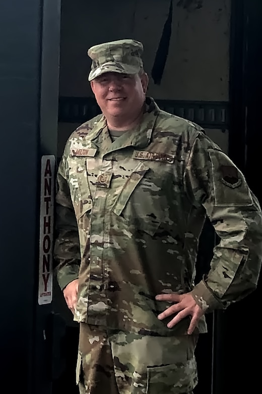 Photo of Tech. Sgt. Melton in his uniform, hands on hips.