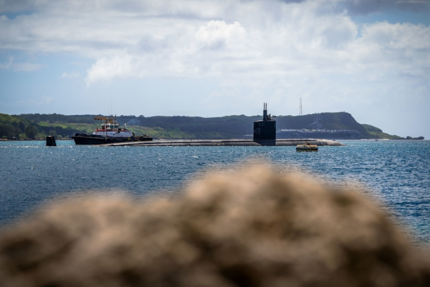 USS Topeka (SSN 754) transits Apra Harbor