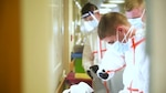 Soldiers and Airmen from the Massachusetts National Guard prepare to decon after caring for residents with COVID-19 at Hathaway Manor Extended Care, New Bedford, Mass., May 7, 2020.