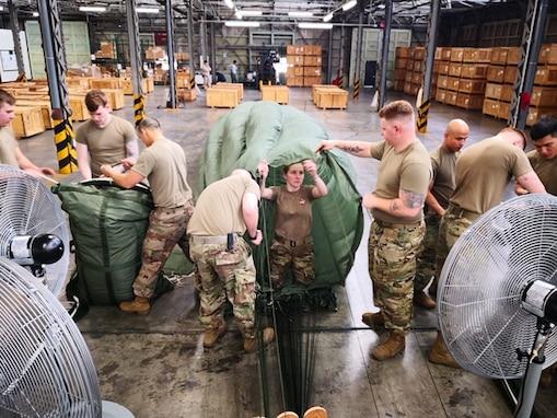 Parachute Riggers pack a G-11 Cargo Parachute.