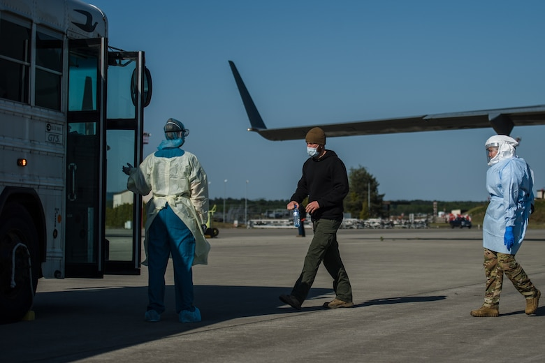 A COVID-19 patient boards an ambulance bus at Ramstein Air Base, Germany, May 16, 2020, after arriving from Afghanistan aboard a C-17 Globemaster III.