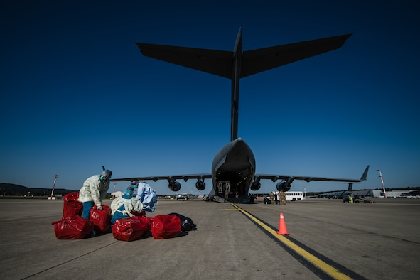 U.S. Air Force medical personnel transfer COVID-19 patients from the flightline at Ramstein Air Base, Germany, to Landstuhl Regional Medical Center, May 16, 2020.