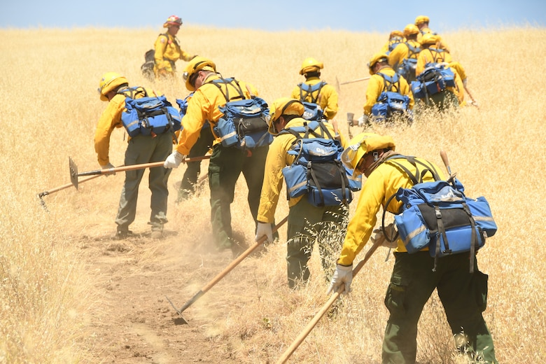 Cal Guardsmen practice cutting fire lines during hand crew training at Camp Roberts on May 14, 2020.