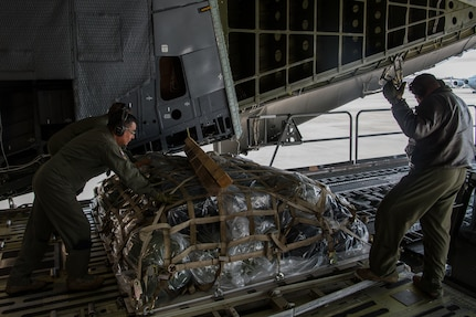 U.S. Reserve Citizen Airmen with the 433rd Airlift Wing's 68th Airlift Squadron, offload cargo belonging to medical personnel who are supporting the residents of New York City in the fight against COVID-19, at Joint Base McGuire-Dix-Lakehurst, N.J., April 5, 2020.