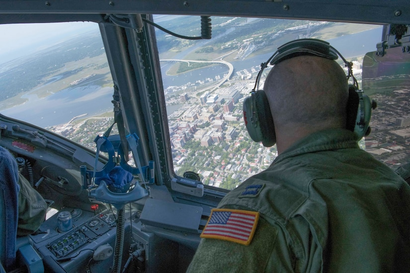 Captain Mike Mothena, Pilot, 315th Airlift Wing, Joint Base Charleston, South Carolina, looks down at medical facilities in Downtown Charleston, May 15, 2020. The flyover was part of OPERATION: AMERICA STRONG, a Salute to medical workers and first responders on the ground.