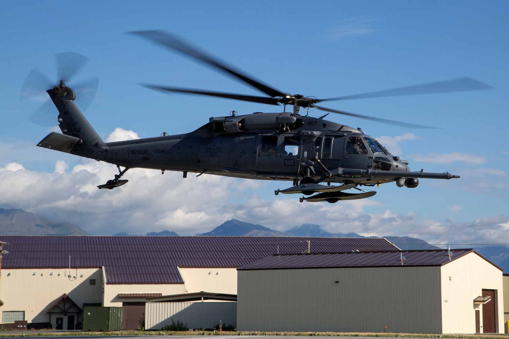 An Alaska Air National Guard HH-60G Pave Hawk helicopter, assigned to the 210th Rescue Squadron, takes off from Joint Base Elmendorf-Richardson, Alaska, July 23, 2015. The 210th Rescue Squadron provides emergency rescue services for the citizens of Alaska in addition to training for wartime combat search-and-rescue missions.