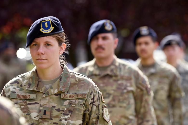 First Lieutenant Jessica Rohrig, 100th Security Forces Squadron operations officer, stands at attention during the 100th SFS Police Week closing ceremony at RAF Mildenhall, England, May 15, 2020. National Police Week is an observance in the United States which pays tribute to local, state and federal officers who've died or who've been disabled in the line of duty. (U.S. Air Force photo by Senior Airman Brandon Esau)