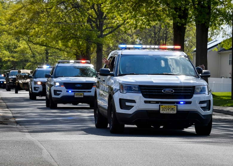 Pemberton Township Police Department drives in a parade for National Police Week at Joint Base McGuire-Dix-Lakehurst, N.J., May 13, 2020. Joint Base MDL partnered with North Hanover, New Hanover, Pemberton, New Jersey State Police and New Jersey Fish & Wildlife to conduct the parade. NPW runs from May 10-16 with the 87th Security Forces Squadron conducting a parade, 24-hour ruck march and a vigil that will honor defenders past and present. (U.S. Air Force photo by Staff Sgt. Jake Carter)
