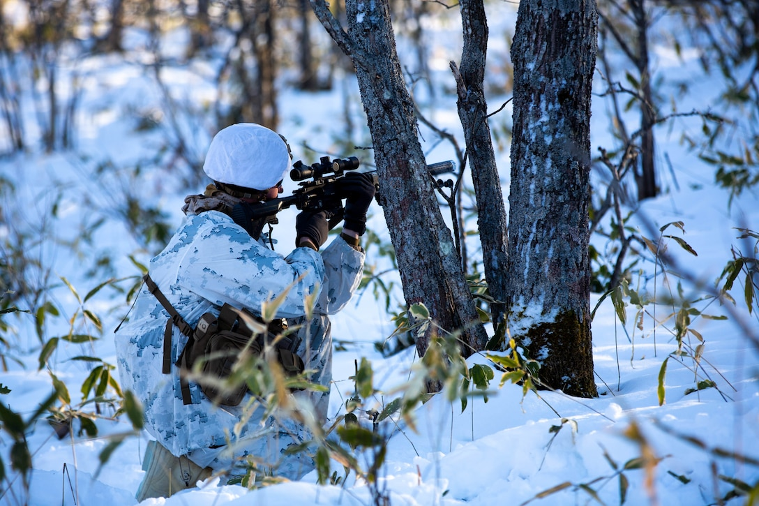 A U.S. Marine posts security on a patrol during exercise Northern Viper on Yausubetsu Training Area, Hokkaido, Japan, Feb. 2, 2020.