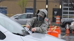 Air National Guard Tech. Sgt. Cara Sturdivant, assigned to the 107th Attack Wing, places paperwork under the windshield of a car at a COVID-19 mobile test site in Buffalo, New York, April 30. Members of the New York National Guard are supporting state agencies testing residents at 14 sites across New York.