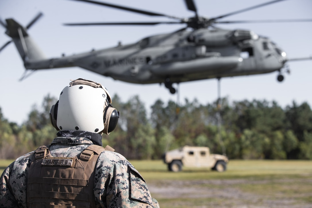 U.S. Marine observes a helicopter during helicopter support team training at Camp Lejeune, North Carolina, May 11, 2020.