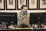 Maj. John Shepherd, public health officer and Air National Guardsman with the plans team, conducts daily operations at Stout Field, Indianapolis May 6, 2020. The Guard's COVID-19 plans team filled a critical component in organizing specialized teams while protecting the health and safety of soldiers and airmen serving on the frontlines.