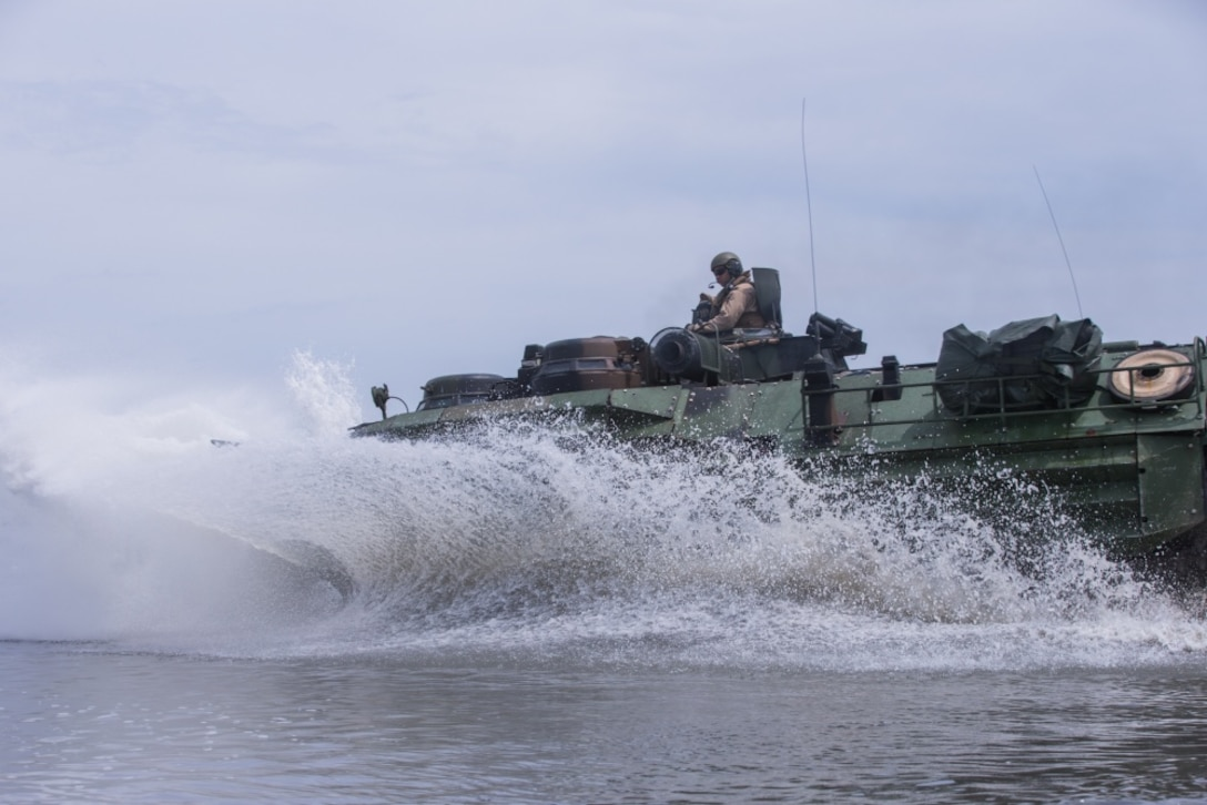 U.S. Marines with 2d Assault Amphibious Battalion (AABn), 2d Marine Division (MARDIV) conduct raid rehearsal training in an amphibious assault vehicle at Camp Lejeune, North Carolina, May 6, 2020. This training focuses on Marines' abilities to enter and exit the water efficiently and effectively. (U.S. Marine Corps photo by Lance Cpl. Reine Whitaker)