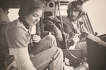 Chief Warrant Officer Mike Cairns talks with Sue Nystrom after rescuing her following the Mount St. Helens eruption on May 18, 1980. Nystrom was so moved by the actions of the National Guard that day she eventually joined the National Guard and served for 34 years.