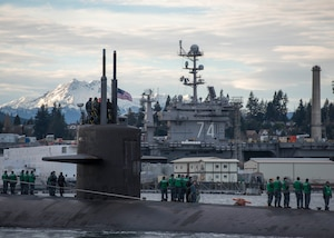he Los Angeles-class fast-attack submarine USS Olympia (SSN 717) arrives at Puget Sound Naval Shipyard for a port visit.