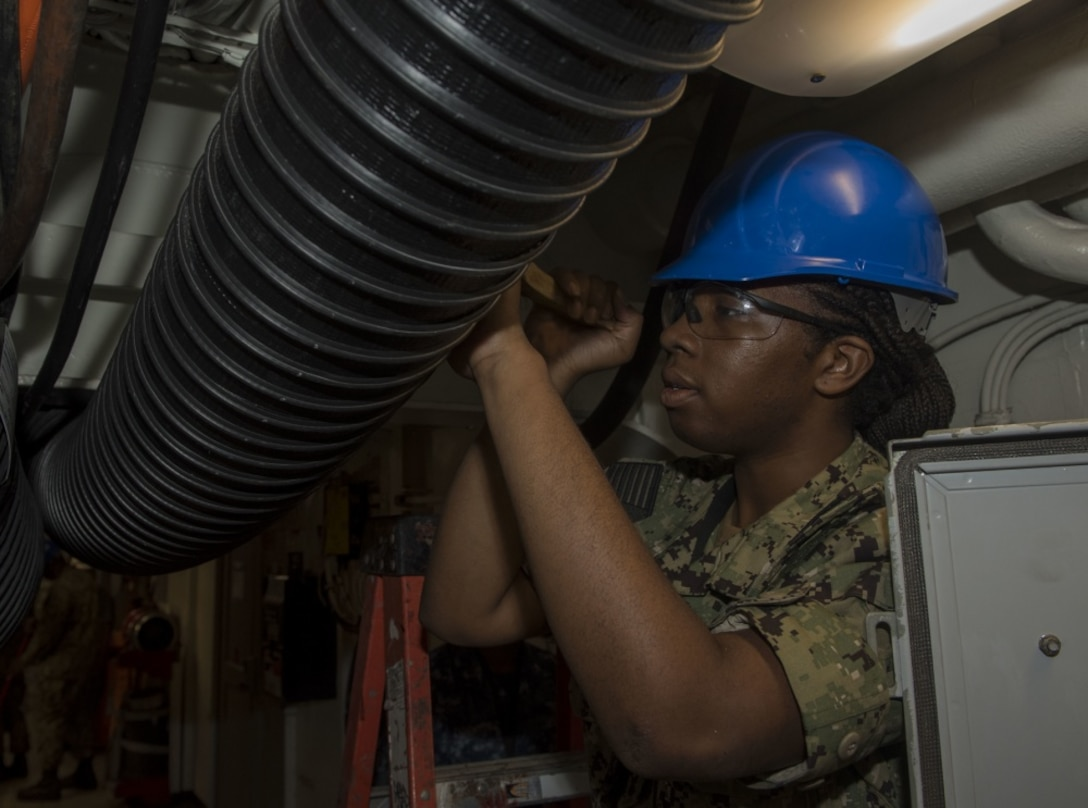 Aviation Electronics Technician 3rd Class Brittany Collins, from Chicago, cleans a ventilation system aboard the aircraft carrier USS George H.W. Bush (CVN 77). GHWB is currently in Norfolk Naval Shipyard for its Docking Planned Incremental Availability (DPIA).
