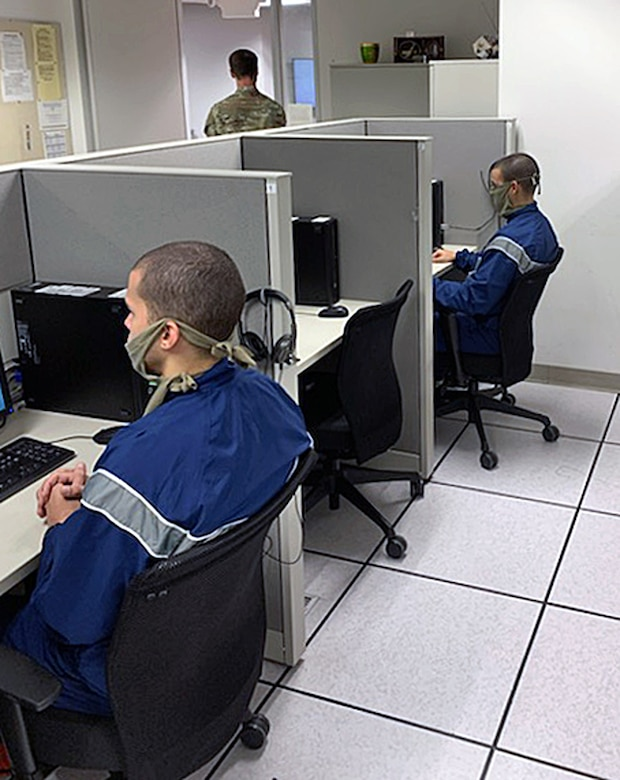 Air Force Echo Flight trainees attend their distance learning classes in the 737th Training Support Squadron learning lab, although separated physically from their classmates to due to COVID-19.