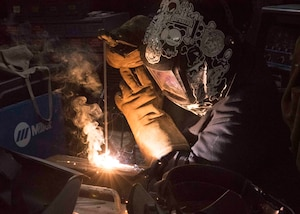 Hull Maintenance Technician Fireman Keriyate Lewis, from New Iberia, La., welds a metal brace aboard the aircraft carrier USS Dwight D. Eisenhower (CVN 69).