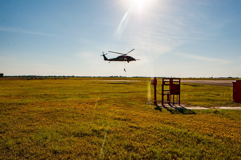 a photo of an Airman exiting a helicopter.