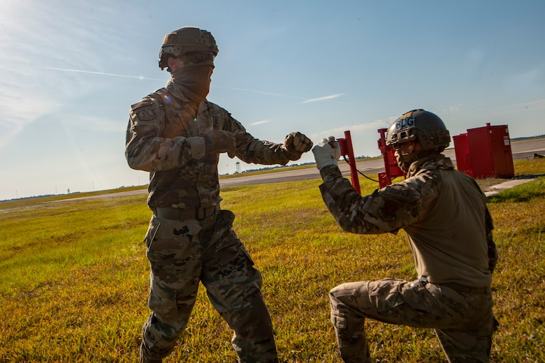 A photo of two Airmen fist bumping.