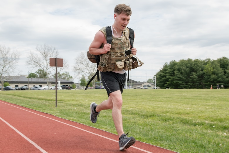 Staff Sgt. Stephen Smith, 436th Security Forces Squadron response force member, runs while wearing body armor and carrying a ruck during the 2020 Police Week Ruck March May 14, 2020, at Dover Air Force Base, Delaware. The 436th SFS hosted the 24-hour event commemorating fallen military and civilian law enforcement officers. (U.S. Air Force photo by Mauricio Campino)