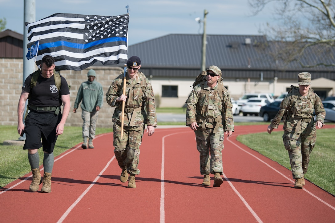 Members of Team Dover participate in the 2020 Police Week Ruck March May 14, 2020, at Dover Air Force Base, Delaware. Over 100 participants walked or ran in the 24-hour event commemorating fallen military and civilian law enforcement officers. (U.S. Air Force photo by Mauricio Campino)
