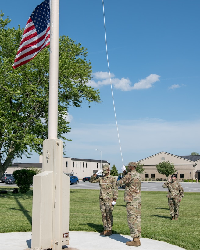 Members of the Dover Air Force Base Honor Guard lower the American flag during a retreat ceremony on Peace Officers Memorial Day May 15, 2020, at Dover Air Force Base, Delaware. The ceremony commemorating fallen military and civilian law enforcement officers marked the end of National Police Week 2020. (U.S. Air Force photo by Mauricio Campino)