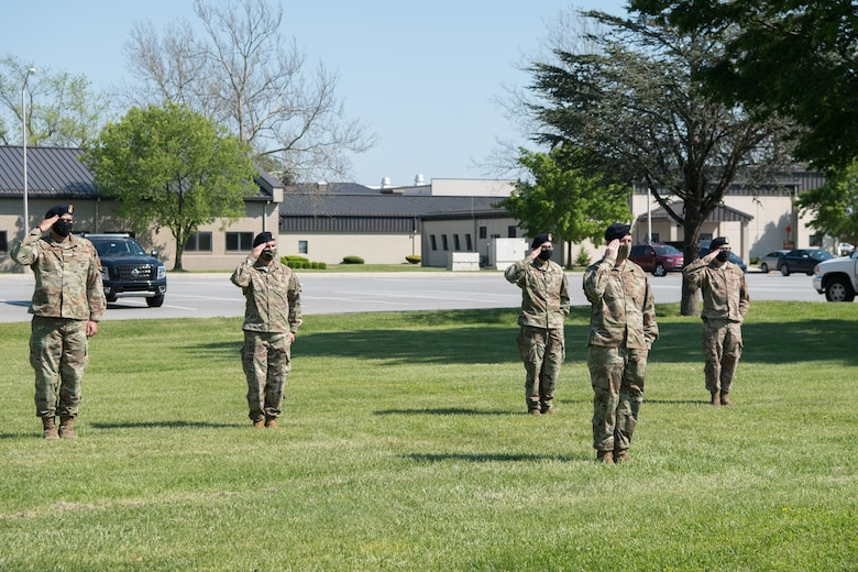 Members of the 436th Security Forces Squadron salute the American flag during a retreat ceremony on Peace Officers Memorial Day May 15, 2020, at Dover Air Force Base, Delaware. Despite the COVID-19 virus, the 436th SFS was able to host the ceremony by limiting the number of participants, practicing social distancing and wearing personal protective equipment. (U.S. Air Force photo by Mauricio Campino)