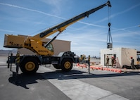 A 30-ton crane lifts a gearbox while Airman guide it into position.
