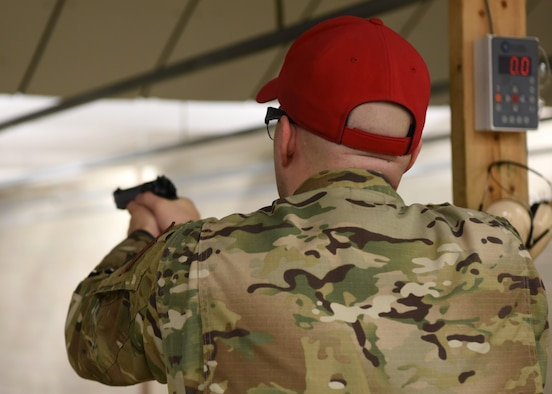 U.S. Air Force Staff Sgt. Christopher Drouin, 17th Security Forces combat arms instructor, lines up his shot during the Excellence in Competition pistol match on Goodfellow Air Force Base, Texas, May 15, 2020. The EIC was held to celebrate police week and gave members of Goodfellow a chance to show their talents off in a friendly competition. (U.S. Air Force photo by Airman 1st Class Ethan Sherwood)