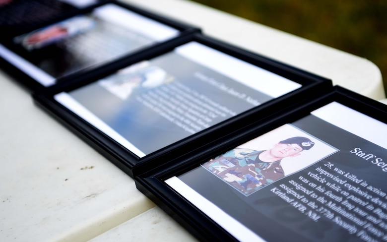 Photos of Air Force Security Forces Airmen who've fallen in the line of duty are displayed during events to commemorate National Police Week at RAF Mildenhall, England, May 13, 2020. National Police Week is an observance in the United States which pays tribute to local, state and federal officers who've died or who've been disabled in the line of duty. (U.S. Air Force photo by Senior Airman Brandon Esau)